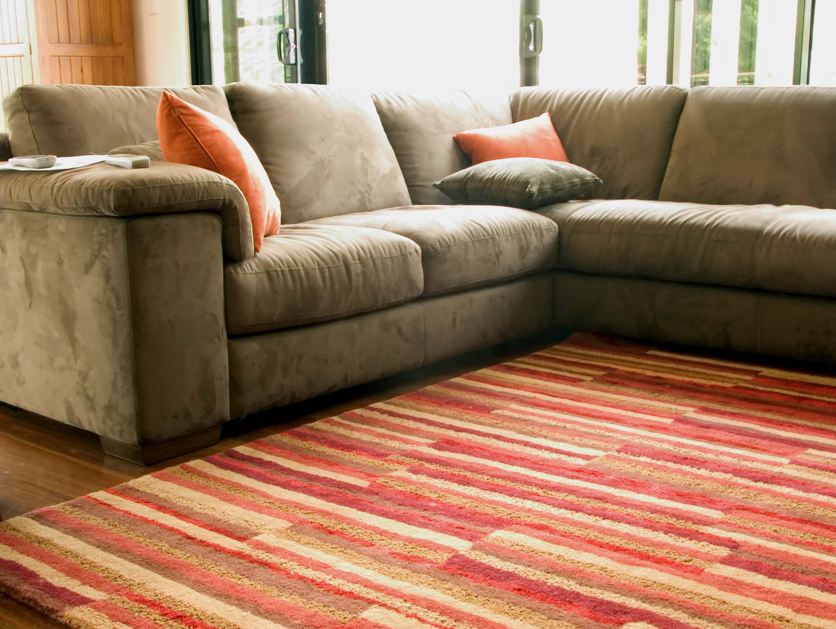 Useful area rug tips for your small living space blog for Can you put an area rug on carpet